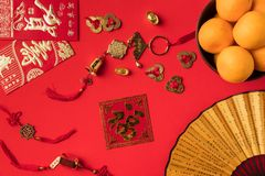 Top view of fan with characters greeting cards with calligraphy oriental decorations and tangerines. Isolated on red stock photo