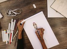Fashion designer making a drawing in her studio stock photos