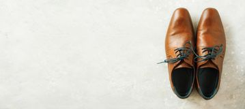 Top view of fashion male shoes on gray background. Sale and shopping concept. Copy space. Top view of fashion male shoes on gray background. Sale and shopping Royalty Free Stock Photos