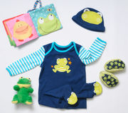 Top view fashion trendy look of baby boy clothes and funny frog Stock Photography