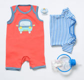 Top view fashion trendy look of baby boy clothes and stuff. Top view fashion trendy look of baby clothes and toy stuff, baby fashion concept Royalty Free Stock Photo
