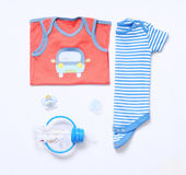 Top view fashion trendy look of baby boy clothes and stuff. Top view fashion trendy look of baby clothes and toy stuff, baby fashion concept Stock Image