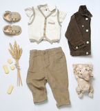 Top view fashion trendy look of baby boy clothes with toy and co Royalty Free Stock Photos