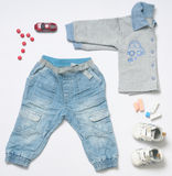 Top view fashion trendy look of baby boy clothes with toy. Top view fashion trendy look of baby clothes and toy stuff, baby fashion concept royalty free stock image