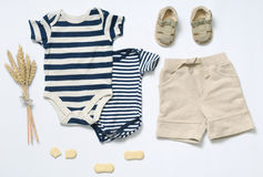 Top view fashion trendy look of baby boy clothes. Top view fashion trendy look of baby clothes and toy stuff, baby fashion concept stock photo