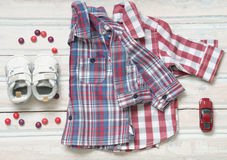 Top view fashion trendy look of baby boy shirts with toy and swe Stock Photo