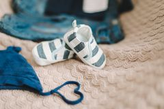 Top view fashion trendy look of baby clothes, fashion concept.  A pair of baby boy shoes. Set of baby clothes and accessories on light background, flat lay royalty free stock photos
