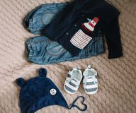 Top view fashion trendy look of baby clothes, fashion concept.  A pair of baby boy shoes. Set of baby clothes and accessories on light background, flat lay royalty free stock images