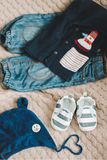 Top view fashion trendy look of baby clothes, fashion concept.  A pair of baby boy shoes. Set of baby clothes and accessories on light background, flat lay stock images