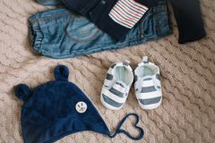 Top view fashion trendy look of baby clothes, fashion concept.  A pair of baby boy shoes. Set of baby clothes and accessories on light background, flat lay royalty free stock photography