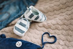 Top view fashion trendy look of baby clothes, fashion concept.  A pair of baby boy shoes. Set of baby clothes and accessories on light background, flat lay royalty free stock photo