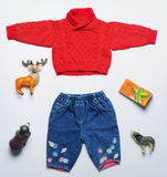 Top view fashion trendy look of baby clothes and toy stuff. Baby fashion concept Stock Photography