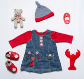 Top view fashion trendy look of baby girl clothes and toy stuff. Baby fashion concept Royalty Free Stock Photography