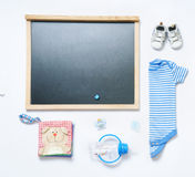 Top view fashion trendy look of blackboard and baby stuff. Baby fashion concept Stock Images