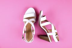 Top view of fashionable feminine medium heeled women`s leather shoes of pastel colors on heels / wedge for spring-summer season. Stylish classic white women`s stock images