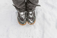 Top view of feet in boots and gaiters snow protection in the sno Royalty Free Stock Image