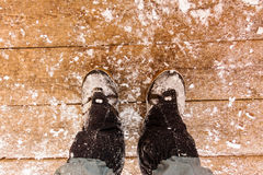 Top view of feet in boots and gaiters snow protection in the sno Stock Image