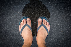 Top view feet in sandals selfie shot of asian men legs with wet Royalty Free Stock Photography