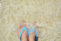 Feet women and sandal on the beach. Top view feet women and sandal on the beach Royalty Free Stock Photography