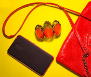 Top view of female accessories and phone on a blue background Royalty Free Stock Image