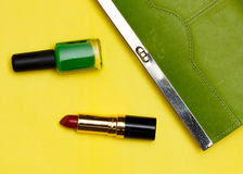 Top view of female fashion accessories . Green handbag with lipstick stock photography