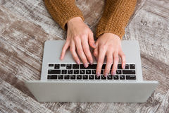 Top view of female hands typing on laptop keyboard Stock Photo