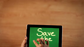 Top view female hands writing Save the planet bold stock video