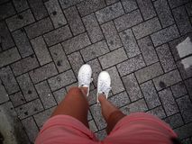 Top view of female legs standing on a rock pavement in Tokyo, Japan royalty free stock photos