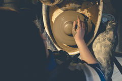 Top view of female potter at work Royalty Free Stock Photo