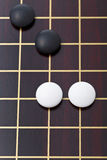 Top view of few stones during go game playing. On goban close up Stock Images