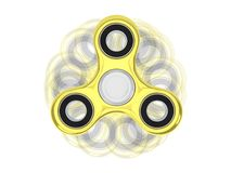 Top view of fidget spinner golden toy with roatation trails Royalty Free Stock Photo