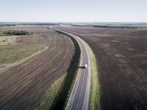 Top view of the field road with car. Aerial.  royalty free stock image