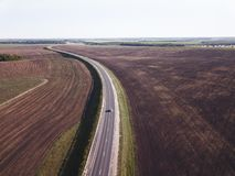 Top view of the field road with car. Aerial.  stock photos