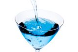 Top of view of filling a glass with blue cocktail tilted and bubbles Stock Image