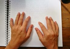 Finger Touch To Braille Code, Blind Man Read Book Writt. Top View Finger Touch To Braille Code, Blind Man Read Book Written In Braille Royalty Free Stock Images