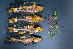 Top view of fish skeleton bones and flavor peppers on slate back stock photography