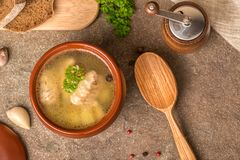 Top view of fish soup with sturgeon, potatoes in clay plate, dec stock photography