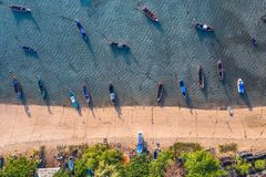 Top view fishing boats in the shore. During low tide at Rawai beach Phuket Thailand stock photos