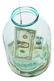 Top view of fishing out dollars from glass jar Stock Images