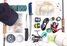 Top view on fishing tackles. With white background. mokap for outdoore adventure business stock image