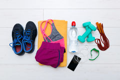 Top view of fitness workout items on gym floor stock photography
