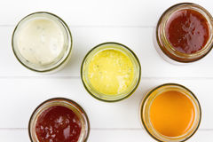 Top-view of five jars filled with sauces Stock Images