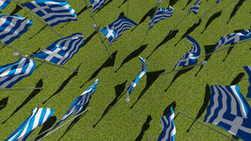 Top view of the flags of Greece fluttering in the wind in the field. Stock Images