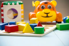 Top view or flat lay on colorful toys on wooden background with copy space. Warm vintage filter Royalty Free Stock Image