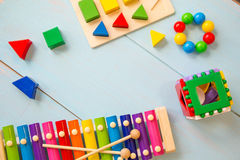 Top view or flat lay on colorful toys on wooden background with copy space. Warm vintage filter Stock Photos