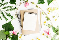 Top view flat lay empty note book with summer leaves and daisy flowers mockup Royalty Free Stock Photography