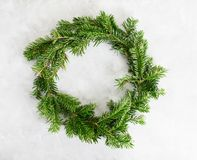 Top view flat lay green Christmas wreath on bright background. Traditional New year decoration concept. Space. For lettering stock photos