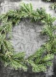 Top view flat lay green Christmas wreath on chalkboard covered with white chalk. Traditional New year decoration concept. Space. For lettering royalty free stock photo