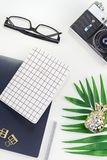 Styled design office workspace desk with camera. Top view flat lay office workspace desk styled design office supplies tropical palm leaves smartphone camera royalty free stock photo