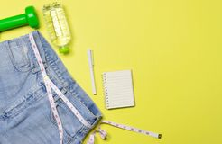 Top view,flat lay an old blue jean style with measuring on paste stock photography